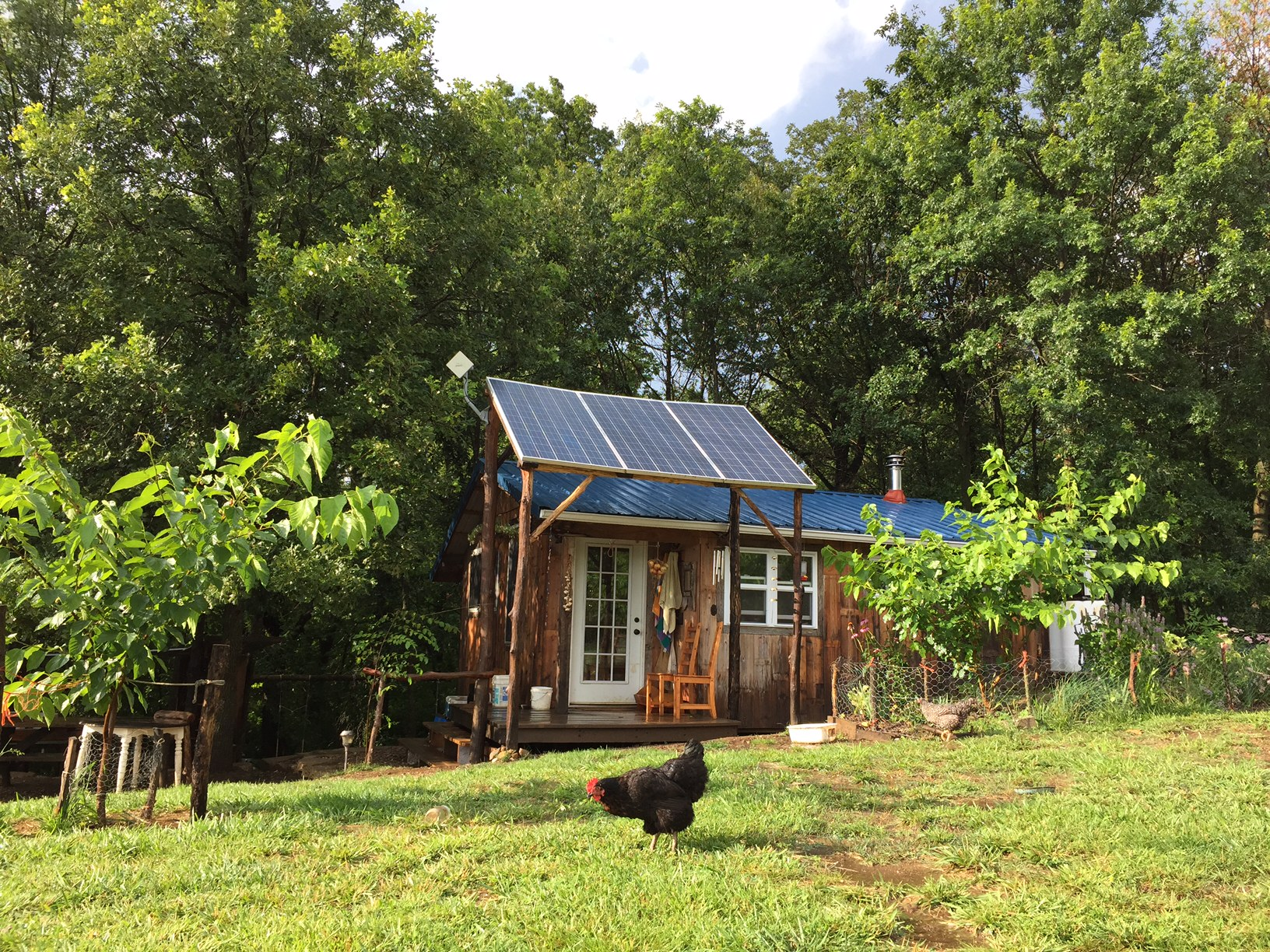 Living large reveals a tiny off grid homestead for four for How to build a small house off the grid
